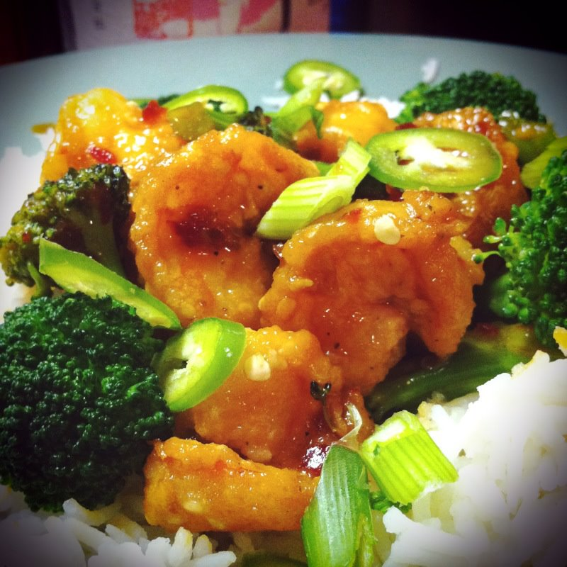 Spicy orange shrimp and broccoli with sliced jalapeno and basmati rice ...